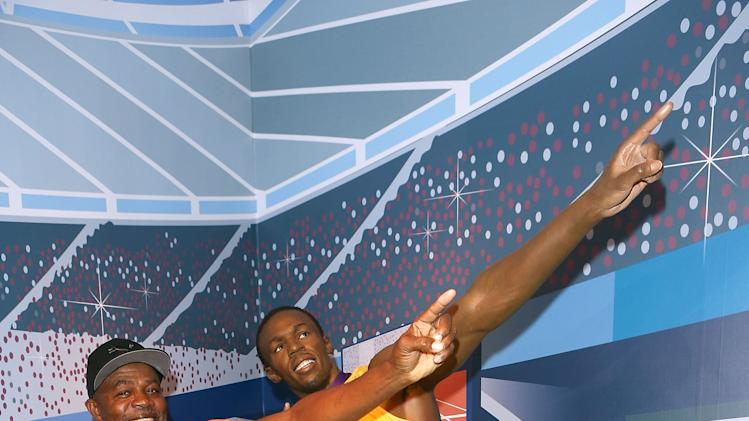 Usain Bolts Parents Pose With Waxwork Figure At Madame Tussauds