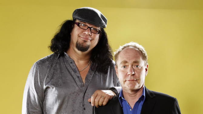 FILE - In this July 21, 2011 file photo, Penn Jillette, left, and Raymond Teller pose for a portrait at the LMT Music Lodge during Comic Con in San Diego. The comedy-and-magic duo said Thursday, March 19, 2015, they will play the Marquis Theatre in New York from July 7-Aug. 16. Tickets go on sale on April 16. (AP Photo/Matt Sayles, File)