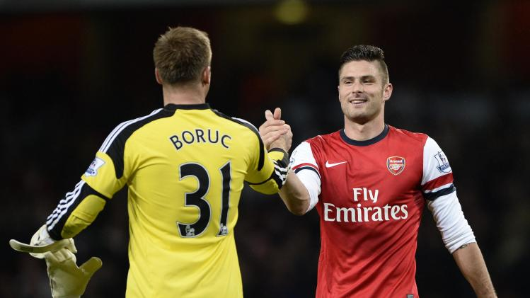Arsenal's Giroud and Southampton's Boruc shake hands at the end of their English Premier League soccer match at the Emirates stadium in London