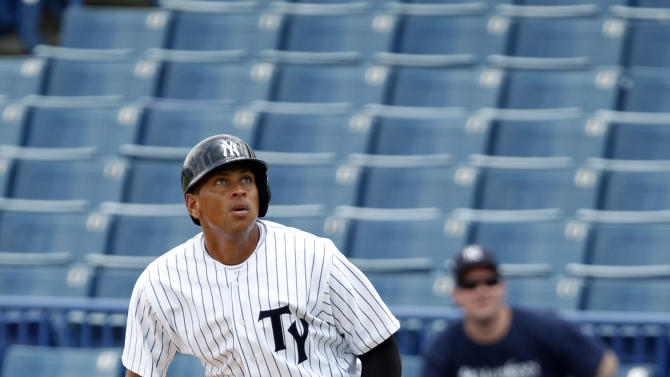New York Yankees' Alex Rodriquez watches a fly ball while on first base during the sixth inning for the Tampa Yankees against the Dunedin Blue Jays in a minor league baseball rehab game in Tampa, Fla., Wednesday, July 10, 2013. (AP Photo/Scott Iskowitz)