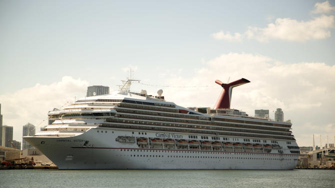 The Carnival Cruise line ship, Victory, sits in port in Miami, Monday, Oct. 14, 2013. A 6-year-old boy drowned on a Carnival Cruise ship, according to Miami-Dade police. The boy, Qwentyn Hunter of Winter Garden, Fla. was in the pool with his 10-year-old brother when he went under water and didn't surface. Other passengers pulled the boy from the water and tried to revive him, according to police. (AP Photo/J Pat Carter)