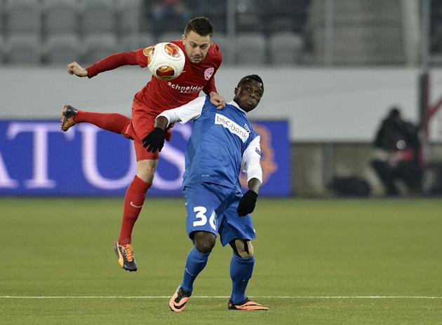Thun's Andreas Wittwer, left, fights for the ball against Genk's Ayub Masika during their Europa League Group G soccer match between Switzerland's FC Thun and Belgiums's KRC Genk at th