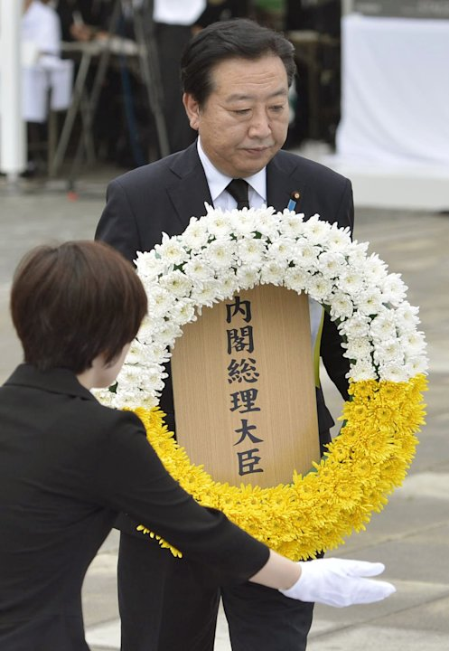 Japan's Prime Minister Yoshihiko Noda offers a wreath during a ceremony held in front of the Statue of Peace at Nagasaki Peace Park in Nagasaki, southern Japan Thursday, Aug. 9, 2012 to mark the 67th 