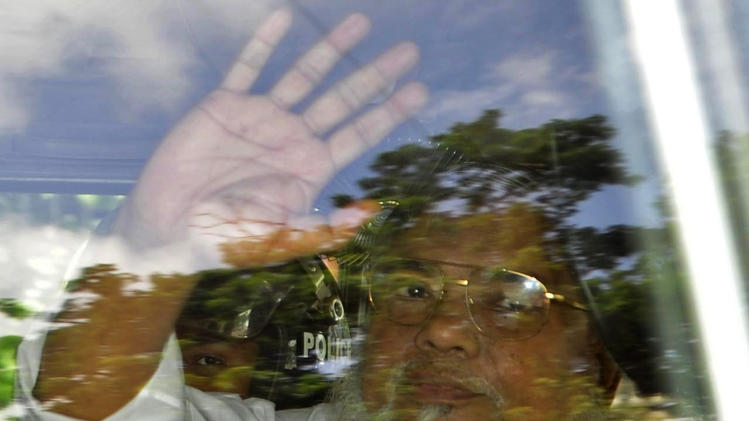 Ali Ahsan Mojaheed, the secretary-general of Bangladesh's Jamaat-e-Islami party, waves from a police vehicle as he is brought to a court in Dhaka, Bangladesh, Wednesday, July 17, 2013. A special tribunal sentenced Mojaheed to death on Wednesday for his role in the kidnapping and killing of people involving Bangladesh's independence war against Pakistan in 1971. (AP Photo)