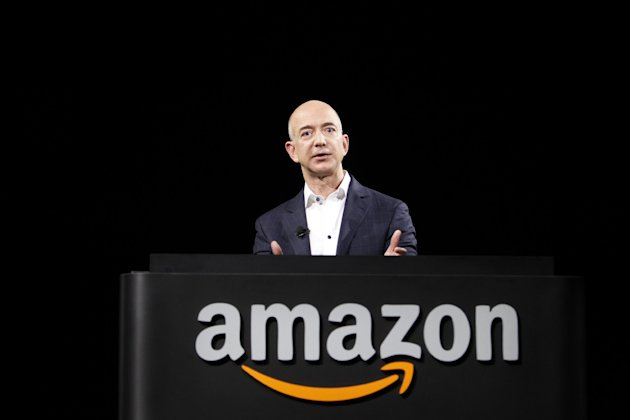 FILE-In this Thursday, Sept. 6, 2012, file photo, Jeff Bezos, CEO and founder of Amazon, speaks at the introduction of the new Amazon Kindle Fire HD and Kindle Paperwhite personal devices, in Santa Monica, Calif. Amazon reported third-quarter results below Wall Streets expectations on Thursday, Oct. 25, 2012, including a large loss that was weighed by its stake in its online deals service LivingSocial and continued investments in technology and distribution centers to grow its business. (AP Photo/Reed Saxon)