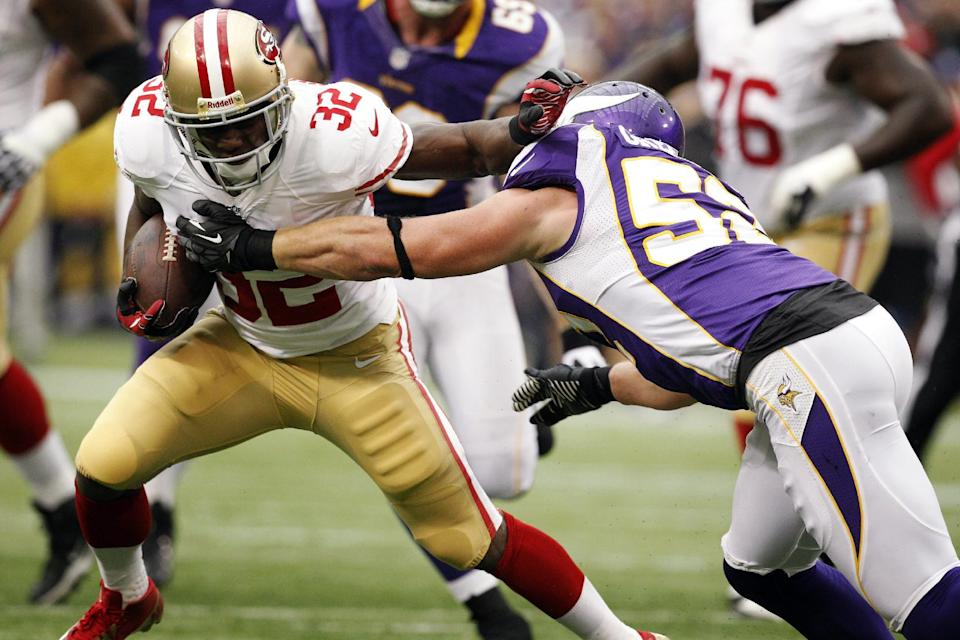 San Francisco 49ers running back Kendall Hunter (32) tries to break a tackle by Minnesota Vikings outside linebacker Chad Greenway, right, during the first half of an NFL football game, Sunday, Sept. 23, 2012, in Minneapolis. (AP Photo/Genevieve Ross)