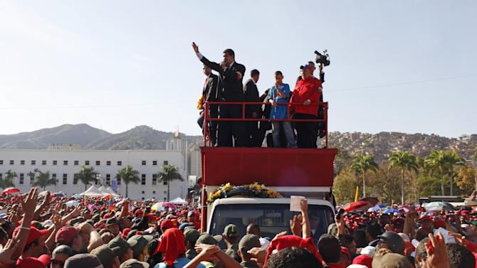 Venezuela's Vice President Nicolas Maduro speaks to people outside the military academy where the body of Venezuela's late President Hugo Chavez is lying in state in Caracas, Venezuela, Thursday, March 7, 2013.  Maduro, Venezuela's acting president, said Chavez's remains will be put on permanent display at the Museum of the Revolution, close to the presidential palace where Chavez ruled for 14 years. A state funeral for Chavez attended by some 33 heads of government is scheduled to begin Friday morning. Chavez died on March 5 after a nearly two-year bout with cancer.  He was 58.  (AP Photo/Rodrigo Abd)