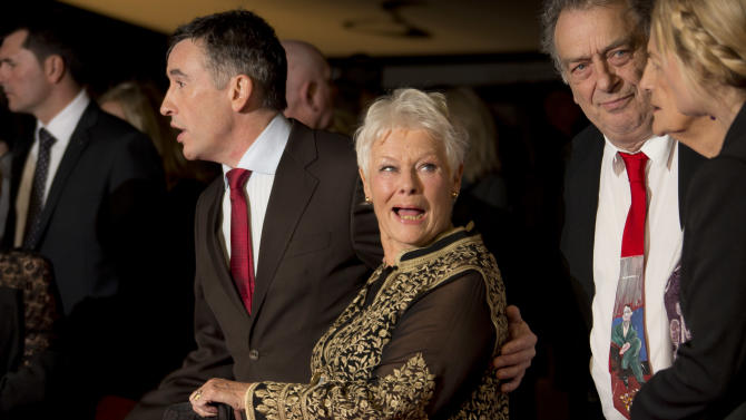 British actors Steve Coogan, left, and Judi Dench, second from left, arrive with British director Stephen Frears, second from right, for the screening of Philomena, as part of the 57th BFI London Film Festival, at a central London cinema, Wednesday, Oct. 16, 2013. (Photo by Joel Ryan/Invision/AP)