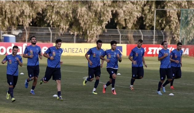 Greece's players run during a training session in Athens, Monday, Oct. 14, 2013, ahead of their 2014 World Cup Group G qualifying match against Liechtenstein on Tuesday
