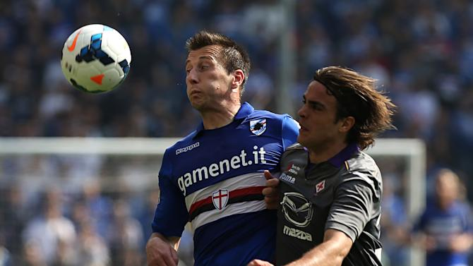 Sampdoria defender Daniele Gastaldello, left, and Fiorentina forward Alessandro Matri fight for the ball during a Serie A soccer match between Sampdoria and Fiorentina, in Genoa, Italy, Sunday, March 30, 2014