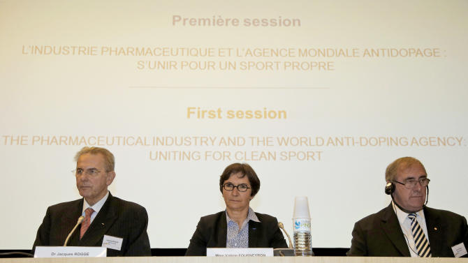 """International Olympic Commitee President Jacques Rogge, left, French Sports minister Valerie Fourneyron and and John Fahey, the head of the World Anti-Doping Agency, right, attend a symposium called """"The Pharmaceutical Industry and the Fight against Doping : New Partnerships for Clean Sport"""" in Paris Monday, Nov. 12, 2012. The international conference is looking at ways to unite the pharmaceutical industry and sports authorites in the fight against doping (AP Photo/Francois Mori)"""