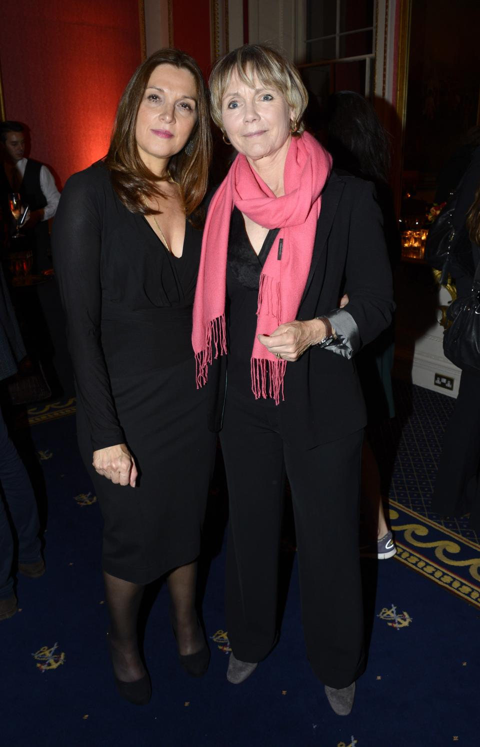 "FILE - In thsi Mon., Oct. 1, 2012 file photo, Barbara Broccoli, left, and Lucy Fleming pose at ""Everything or Nothing - The Untold Story of 007"" After Party at Odeon West End, in London. (Photo by Jon Furniss/Invision, File)"