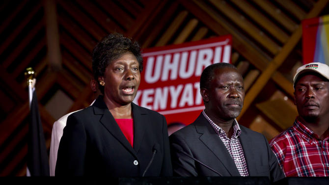Charity Ngilu, left, a senior member of the Jubilee Coalition which includes Uhuru Kenyatta's The National Alliance party, speaks at a press conference at the Catholic University in Nairobi, Kenya Wednesday, March 6, 2013. Election officials in Kenya began counting ballots by hand on Wednesday after the early returns electronic system broke down, while a senior member of presidential candidate Uhuru Kenyatta's coalition levied charges against Britain's High Commissioner in Kenya that the U.K. is meddling in the vote tallying process. (AP Photo/Ben Curtis)