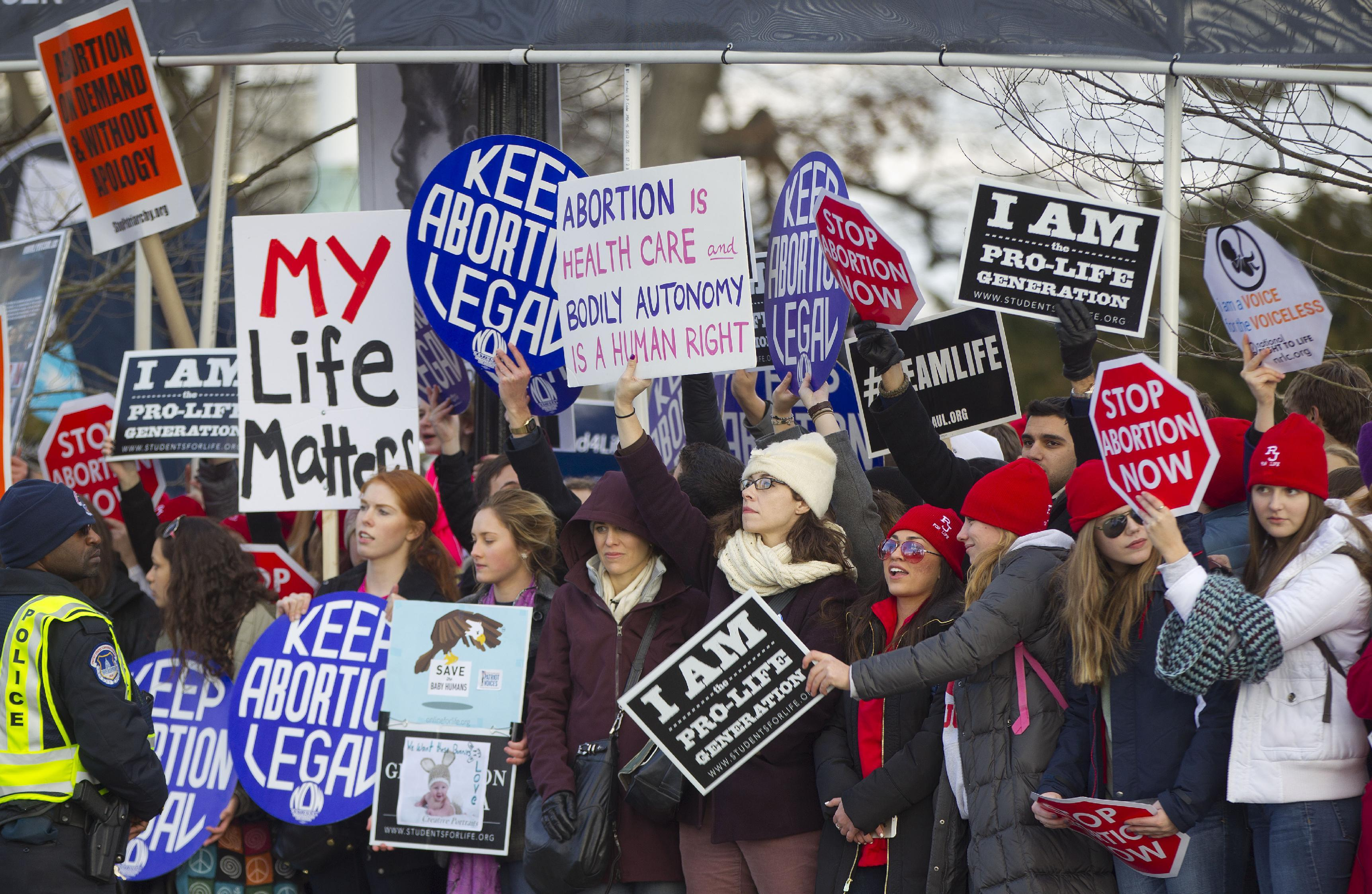 Pro-life and anti-abortion demonstrators converge in front of the Supreme Court in Washington