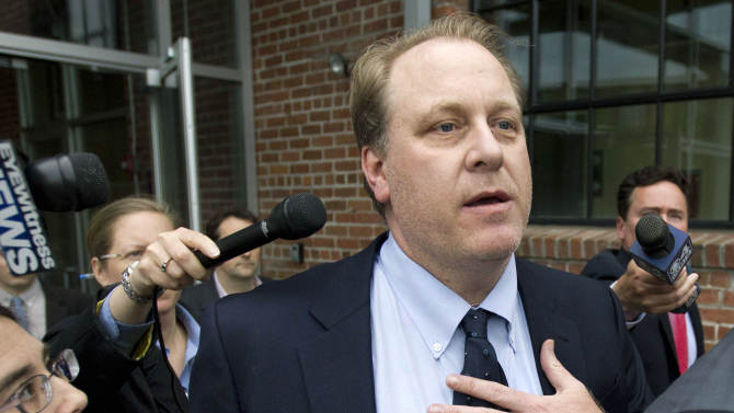 FILE - In this Wednesday, May 16, 2012, file photo, former Boston Red Sox pitcher Curt Schilling, center, is followed by members of the media as he departs the Rhode Island Economic Development Corporation headquarters, in Providence, R.I. Superior Court Judge Michael Silverstein ruled Wednesday, Aug. 28, 2013, that the Economic Development Corp., can proceed with its lawsuit against Schilling, other former 38 Studios executives, and former EDC officials including former Executive Director Keith Stokes. The suit alleges fraud, negligence, breach of fiduciary duty, racketeering and conspiracy. It says the board was misled into approving a $75 million loan guarantee for the company in 2010. (AP Photo/Steven Senne, File)