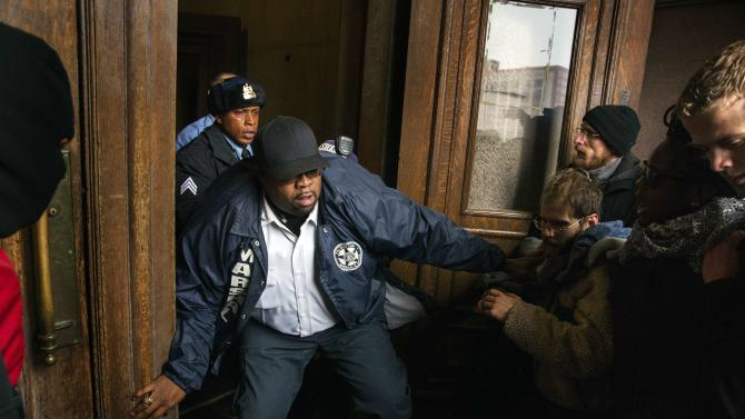 A City Marshal tries to stop a group of protesters from entering St. Louis City Hall in St. Louis