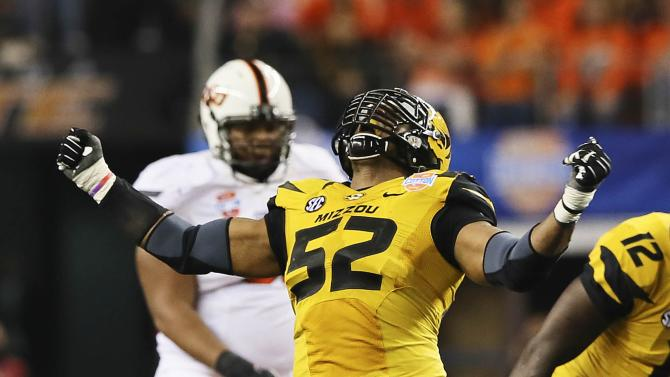 Missouri Tigers defensive lineman Michael Sam (52) reacts after a play during the second half against the Oklahoma State Cowboys in the 2014 Cotton Bowl at AT&T Stadium in Arlington