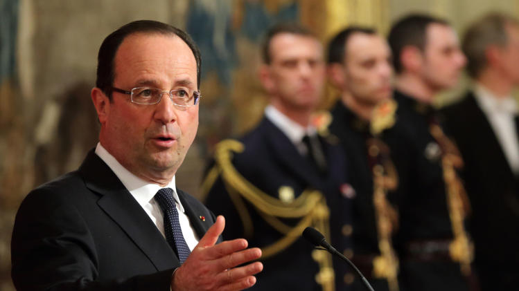 Hollande pledges clean sweep amid corruption probe