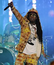 FILE - In this March 1, 2012 file photo, Lil Wayne performs at the Caesars Entertainment &quot;Escape To Total Rewards&quot; concert, in Los Angeles. The multiplatinum rapper was hospitalized on Friday night, March 15, 2013, and reps confirmed he was &quot;recovering.&quot; A person close to the superstar rapper&#39;s camp who asked for anonymity because of the sensitivity of the matter confirmed to The Associated Press that Lil Wayne had a seizure. (AP Photo/Chris Pizzello, File)