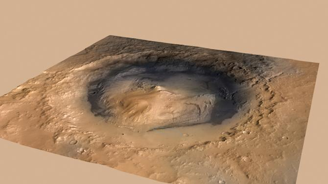 This image provided by NASA shows the Gale Crater Martian landing site for the Curiosity Mars rover. The Gale Crater is approximately the size of Connecticut and Rhode Island combined. The image was taken by the Mars Reconnaissance Orbiter. (AP Photo/NASA)