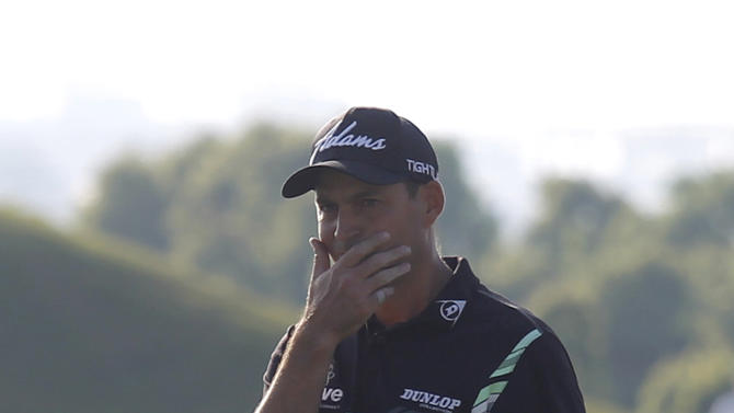 David Howell of England reacts after missing a putt on the 18th green during the final round of the Volvo China Open golf tournament in Shanghai, China, Sunday April 26, 2015. Howell lost to Wu Ashun of China by one stroke. (AP Photo)