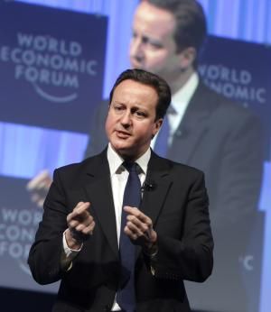 British Prime Minister David Cameron addresses a session at the World Economic Forum in Davos, Switzerland on Friday, Jan. 28, 2011. In a nod to the post-crisis atmosphere, the World Economic Forum shifts its attention on Friday to austerity measures and priorities for improving the economy. (AP Photo/Michel Euler)