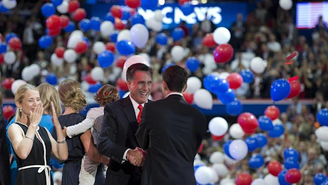 Republican presidential candidate, former Massachusetts Gov. Mitt Romney shakes hands with running mate Rep. Paul Ryan, R-Wis., after a speech to the Republican National Convention on Thursday, Aug. 30, 2012 in Tampa, Fla.  (AP Photo/Evan Vucci)
