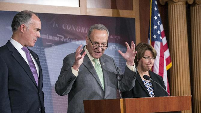 Sen. Chuck Schumer, D-N.Y., chairman of the Rules Committee, center, flanked by Sen. Robert Casey, D-Pa., left, chairman of the Subcommittee on Fiscal Responsibility and Economic Growth, and Sen. Amy Klobuchar, D-Minn., right, Senate chair of The Joint Economic Committee, speaks to reporters about the economic consequences of a debt ceiling default, during a news conference at the Capitol, Wednesday, Sept. 18, 2013. House GOP leaders Wednesday announced that they will move quickly to raise the government's borrowing cap by attaching a wish list of GOP priorities like blocking Obamacare, forcing construction of the Keystone XL pipeline and setting the stage for reforming the loophole-cluttered tax code. (AP Photo/J. Scott Applewhite)