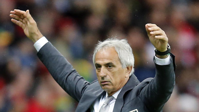 FILE - In this June 30, 2014 file photo, then-Algeria's head coach Vahid Halilhodzic gestures during the World Cup round of 16 soccer match between Germany and Algeria at the Estadio Beira-Rio in Porto Alegre, Brazil. The Japanese soccer association said Thursday, March 5, 2015 it has reached an agreement with Halilhodzic to become national team coach. Masahiro Shimoda, the Japan Football Association's technical committee chairman, says the association is expected to approve the deal at a meeting of its executive board on March 12. Japanese media reported that the 62-year-old Bosnian will be paid an annual salary of $2.2 million. (AP Photo/Frank Augstein, File)