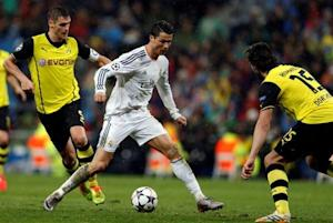 Real Madrid's Ronaldo runs with the ball between Borussia Dortmund's Durm and Hummels during their Champions League quarter-final first leg soccer match at Santiago Bernabeu stadium in Madrid