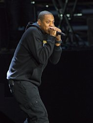 FILE - In this Nov. 5, 2012 file photo, Jay-Z performs at the grassroots rally in support of President Barack Obama at the Nationwide Arena in Columbus, Ohio. Jay-Z is among the six nominees with a leading six nods for the 55th annual Grammy Awards, announced Wednesday night, Dec. 5, 2012, at Bridgestone Arena in Nashville, Tenn. (Photo by Barry Brecheisen/Invision/AP, File)