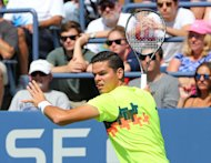 Aug 30, 2014; New York, NY, USA; Milos Raonic (CAN) returns a shot to Victor Estrella Burgos (DOM) on the Grandstand Court on day six of the 2014 U.S....