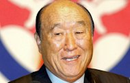 Unification Church founder Sun Myung Moon, pictured in 2002, built his first place of worship from scrap materials some 60 years ago and went on to establish a controversial religious and business empire spanning the globe