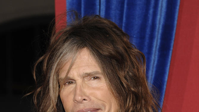 """FILE - This March 11, 2013 file photo shows singer Steven Tyler arriving at the world premiere of the feature film """"The Incredible Burt Wonderstone"""" in Los Angeles. The future is looking bleak for the Hawaii celebrity privacy bill known as the Steven Tyler Act.  The proposal pushed by the Aerosmith lead singer is missing deadlines in the state House and key lawmakers say they won't push it through. The bill to prevent unwanted photos and video people in their private moments sailed through the state Senate earlier this month, after Tyler testified in person at a committee hearing in February.  (Photo by Dan Steinberg/Invision/AP, file)"""