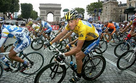 File photo of Discovery Channel team rider Armstrong passing the Arc de Triomphe in Paris after winning his seventh Tour de France