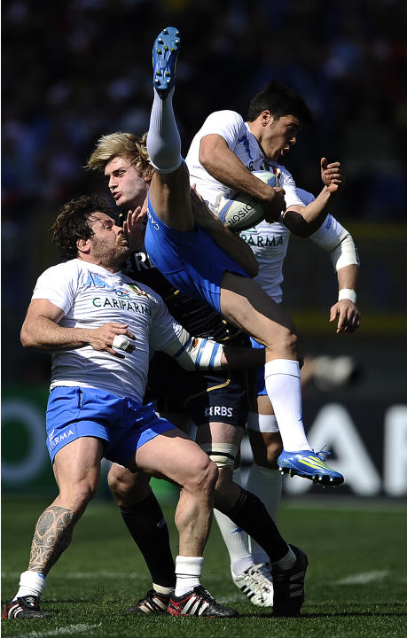 Italy  Quentin Geldnhuys (C) is tackled by Scotland's Richie Gray during their Rugby Union Six Nations match at the Rome's Olympic stadium on March 17, 2012. Italy defeated Scotland 13-6.  AFP PHOTO /