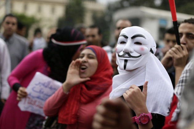 Egyptian protesters chant anti Muslim Brotherhood slogans during a demonstration outside the presidential palace, in Cairo, Egypt, Wednesday, Dec. 5, 2012. Egyptian President Mohammed Morsi's supporte