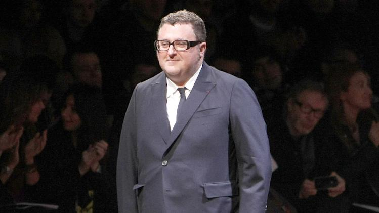 FILE - This Jan. 23, 2011 file photo shows Israeli fashion designer Alber Elbaz at the end of the French fashion house Lanvin men's fall-winter 2011/2012 collection presented in Paris. Makeup powerhouse Lancome announced Monday, Jan. 14, 2013 that Elbaz will have a line of cosmetics,  Lancome x Alber Elbaz, launching in June. (AP Photo/Jacques Brinon, file)