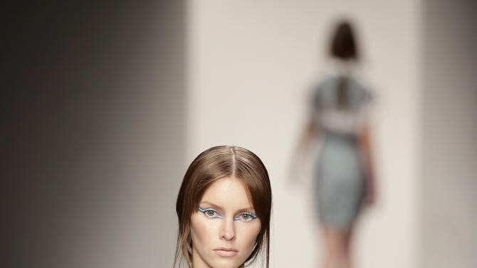 A model presents a design by Jean-Pierre Braganza during his Spring/Summer 2013 show at London Fashion Week in London, Friday, Sept. 14, 2012. (AP Photo/Alastair Grant)