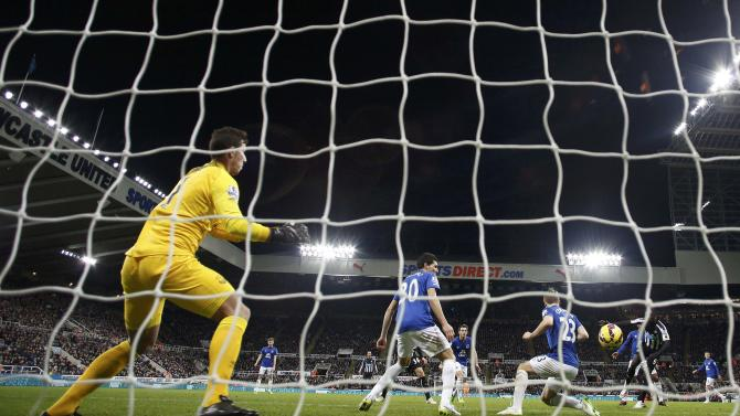 Newcastle United's Papiss Demba Cisse shoots to score a goal against Everton during their English Premier League soccer match at St James' Park in Newcastle