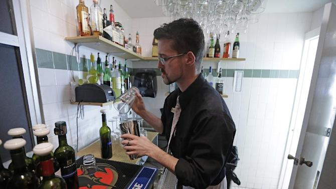 """FILE - In this Feb. 26, 2013, file photo, manager Dustin Humes fixes a drink in a small room which is out of the view of patrons at Vivace Restaurant, in Salt Lake City. The Mormon church has issued a sweeping defense of Utah's famously strict liquor laws, drawing a line against tourism, restaurant and bar industry advocates who have helped ease alcohol regulations in recent years. Ahead of the upcoming legislative session, The Church of Jesus Christ of Latter-day Saints posted to its website a hefty multimedia policy statement urging lawmakers to uphold rules that church leaders say are """"closely tied to the moral culture of the state."""" (AP Photo/Rick Bowmer, File)"""