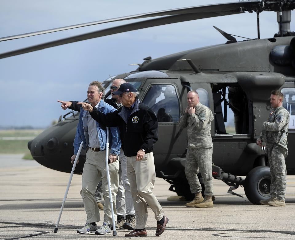 Vice President Joe Biden, center right, arrives with Gov. John Hickenlooper, left, in Greeley, Colo. after surveying the flood damage in the area, Monday, Sept. 23, 2013. (AP Photo/The Denver Post, Kathryn Scott Osler, Pool)