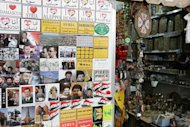 Fridge magnets are displayed at a shop selling items for tourists in the capital Damascus on April 30. Hundreds of dissidents were arrested across Syria on Sunday, including in the flashpoint town of Daraa and a besieged Damascus suburb, after dozens were killed in weekend protests, activists said