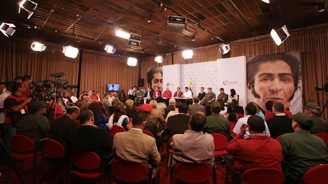 """In this photo released by Miraflores Presidential Press Office, Venezuela's Vice President Nicolas Maduro, top center in white, addresses the nation from Miraflores presidential palace during a meeting with top government ministers, the military high command and all 20 loyalist governors in Caracas, Venezuela, Tuesday, March 5, 2013. Maduro says the government of President Hugo Chavez plans to expel a U.S. Embassy official for meeting with military officers and planning to destabilize the country. Maduro spoke hours after the government said Chavez was in """"very delicate"""" health after undergoing cancer surgery in December. The large images on display in the room are of Venezuela's independence hero Simon Bolivar. (AP Photo/Miraflores Presidential Press Office)"""