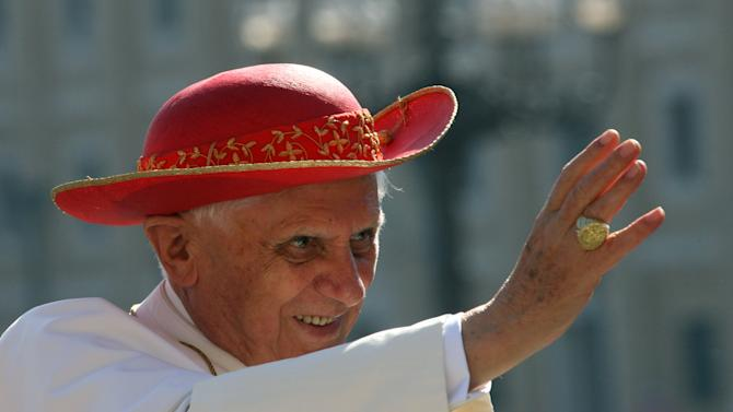 """FILE - This Sept. 6, 2006 file photo shows Pope Benedict XVI wearing a """"saturno hat"""", inspired by the ringed planet Saturn, to shield himself from the sun as he waves to the crowd of faithful prior to his weekly general audience in St. Peter's Square at the Vatican. (AP Photo/Pier Paolo Cito, files)"""