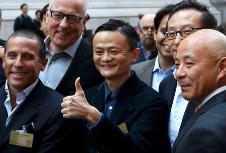 Alibaba Group Holding Ltd founder Jack Ma gestures as he arrives at the New York Stock Exchange for his company's initial public offering in New York