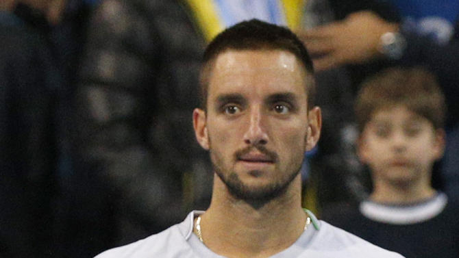 Serbia's Troicki holds runners-up trophy after losing final match of Garanti Koza Sofia Open in Sofia
