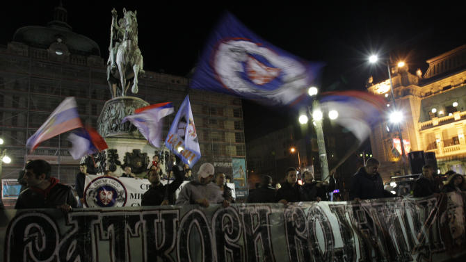 "Protesters wave Serbian flags and banner reads: ""Ratko's soldiers""  (genocide suspect Bosnian Serb army commander Ratko Mladic) during the Serbian nationalists protest in Belgrade, Serbia, Thursday, Nov. 29, 2012. A U.N. war crimes tribunal on Thursday acquitted the former prime minister of Kosovo Ramush Haradinaj and two of his former Kosovo Liberation Army comrades for the second time of murdering and torturing Serbs and their supporters in Kosovo's war for independence. Serbian officials and media had been anticipating for days that Haradinaj would be acquitted less than two weeks after two Croatian generals were cleared of charges of killing and deporting Serbs in a 1995 military blitz, a judgment that sparked rage in Belgrade, where many see the tribunal as anti-Serb. (AP Photo/Darko Vojinovic)"
