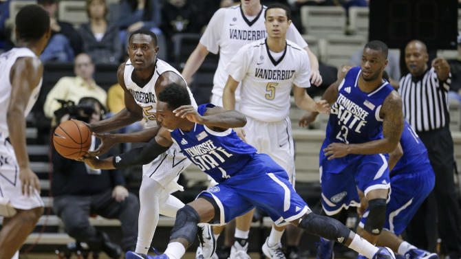 Tennessee State guard Xavier Richards, front, tries to steal the ball from Vanderbilt forward James Siakam (35) in the first half of an NCAA college basketball game, Sunday, Nov. 23, 2014, in Nashville, Tenn. (AP Photo/Mark Humphrey)