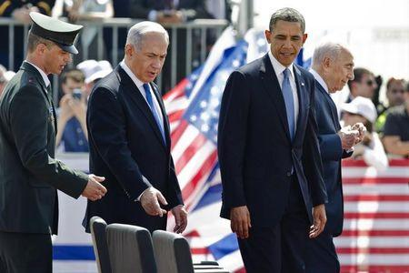 U.S. President Obama, Israeli Prime Minister Netanyahu and President Peres take their seats during an official welcoming ceremony at Ben Gurion International Airport near Tel Aviv
